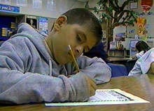 Boy writing on a sheet of paper
