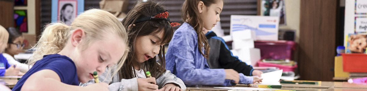 Some Fresno Unified students sitting at a table, working on schoolwork.